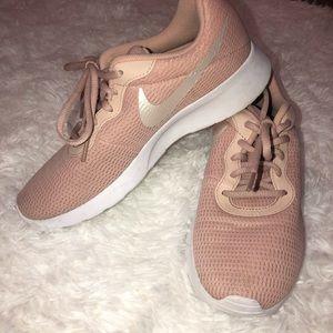 Light pink Nike Roshe tennis shoes